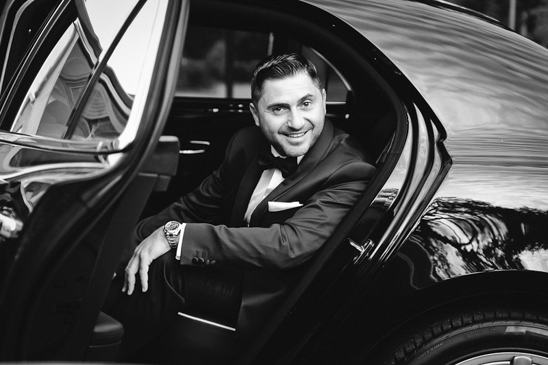 Groom exiting his car in Houston wedding day