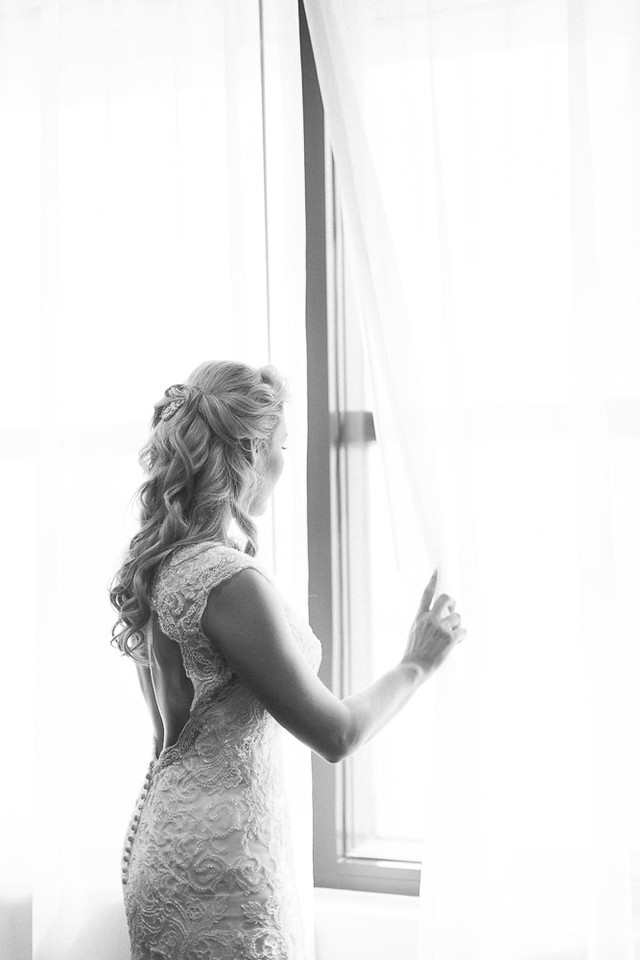 Bride by the window at Houston Real weddings