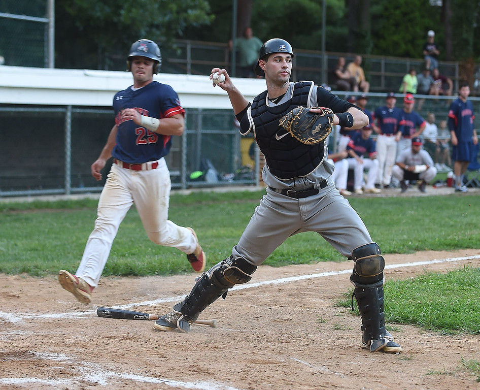 . PETE BANNAN-DIGITAL FIRST MEDIA  WayneChris Cowell looks to first after forcing out Narberth Mike White in the eighth inning at Narberth field Thursday evening in Delco League playoffs. Wayne won 6-4 in extra innings.