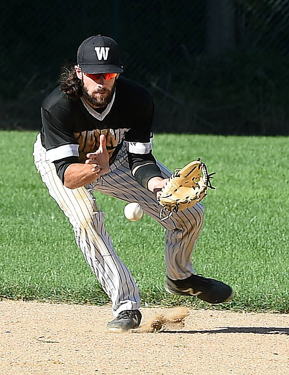 . PETE BANNAN-DIGITAL FIRST MEDIA        Wayne shortstop Dan WIlliams handles the final ut as Wayne came back to defeat Narberth 6-4 in game three of the Delco League playoff championship series at Radnor High School Sunday.