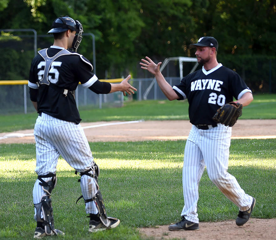 . PETE BANNAN-DIGITAL FIRST MEDIA        Wayne catcher Chris Cowell shakes hands with pitcher  Brandon Menchaca after he got a three out save as Wayne beat Narberth 6-4 in game three of the Delco League playoff championship series at Radnor High School Sunday.