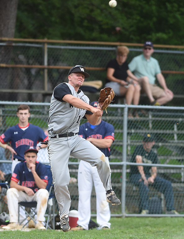 . PETE BANNAN-DIGITAL FIRST MEDIA  Wayne third baseman  Brad Schneider throws out a runner against Narberth at Narberth field Thursday evening in Delco League playoffs. Wayne won 6-4 in extra innings.
