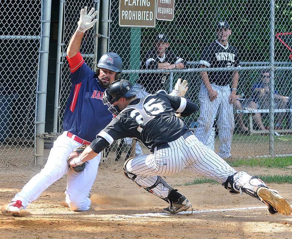 . PETE BANNAN-DIGITAL FIRST MEDIA        Wayne\'s Chris Cowell tags out Narberth #11 Steve DiBarbie coming into home in the fourth inning as Wayne beat Narberth 6-4 in game three of the Delco League playoff championship series at Radnor High School Sunday.
