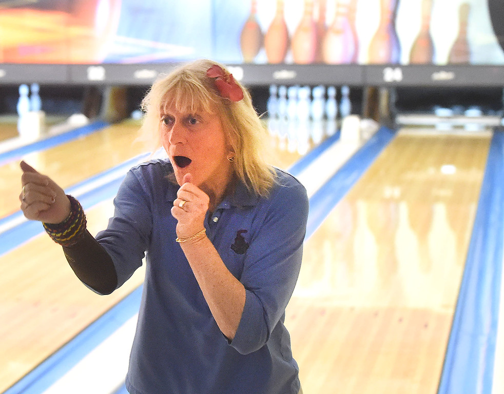 """. PETE  BANNAN-DIGITAL FIRST MEDIA      Margie Widmann of Gladwyne  celebrates a strike  with a little dance during the Early Birds League at Devon Lanes. Widmann said she has been coming to Devon since her children were little.  \""""They had a daycare upstairs, my children were happy and I was happy,\"""" she said."""