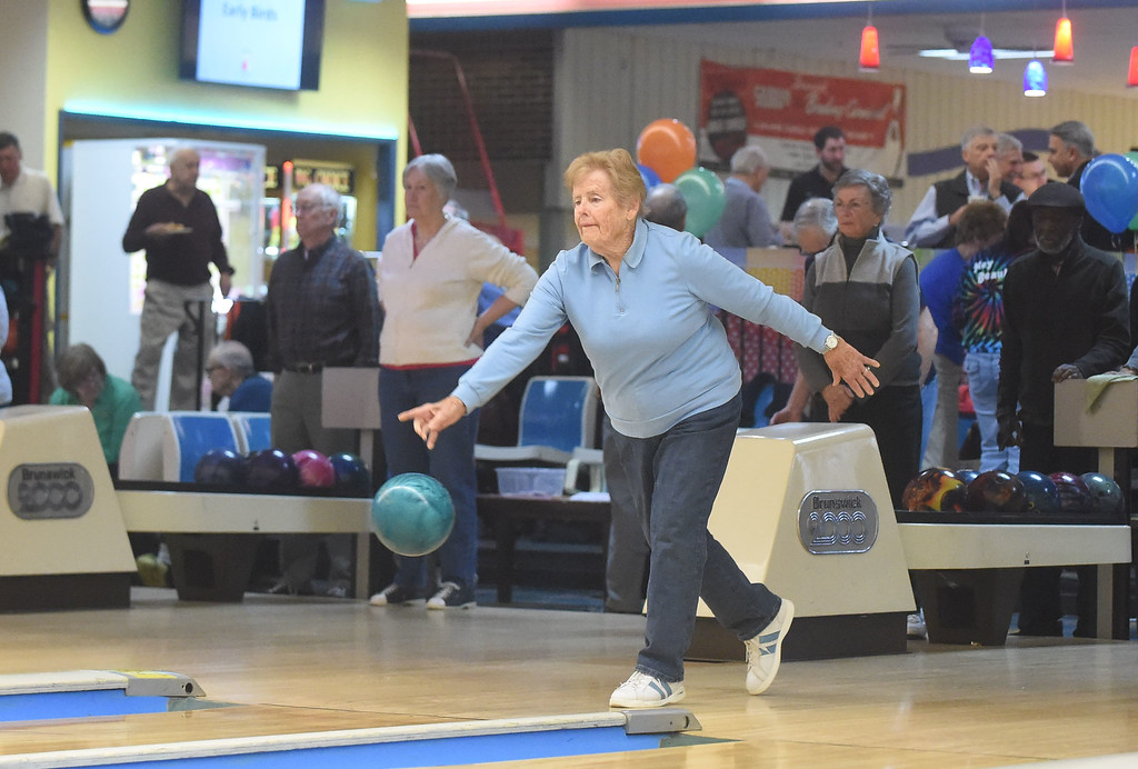 . PETE  BANNAN-DIGITAL FIRST MEDIA      Devon Lanes honored members of the Early Bird League, named for its 9 a.m. start time.  Ellen Millick of West Chester has been bowling at Devon for forty years, and been in the Early Bird League since 1995.