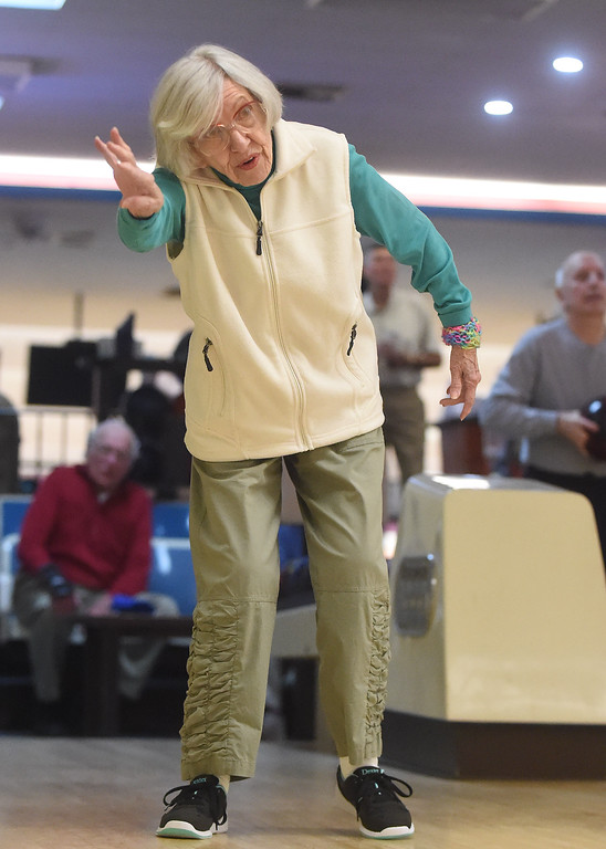 . PETE  BANNAN-DIGITAL FIRST MEDIA      Maggi Richwine,89, of Wayne uses some body english as she bowls.