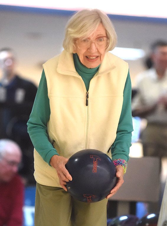 """. PETE  BANNAN-DIGITAL FIRST MEDIA      Maggi Richwine,89,  of Wayne prepares to drop \'the hammer\' her bowling ball at Devon Lanes she\'s been a member of the Early Bird League since 2000. She said her scores have been down recently, \"""" though just last week I bowled a 158,\"""" she said."""