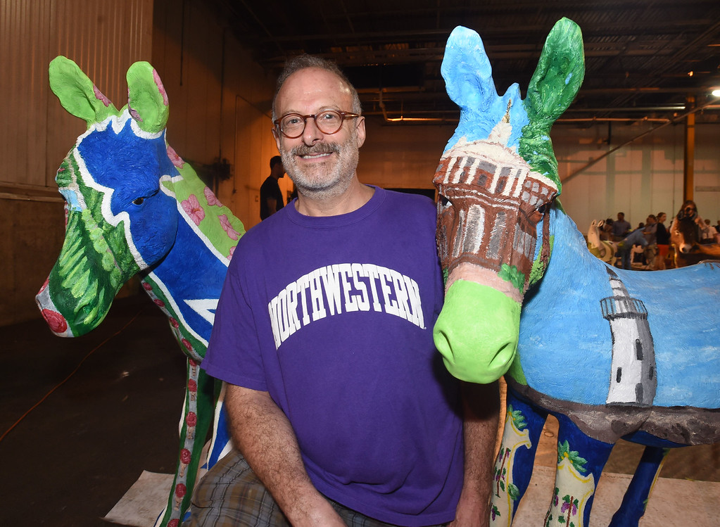 . PETE BANNAN-DIGITAL FIRST MEDIA    The Philadelphia 2016 Host Committee for the Democratic National Convention unveiled 57 fiberglass �Donkeys Around Town.�  Each of the donkeys represents a Democratic delegation that will be in town for the Convention and, upon completion, will be placed around Philadelphia to celebrate the 2016 Democratic National Convention.  Jonathan Mandell of Bala Cynwyd with the two donkeys he painted for Delaware and Connecticut.