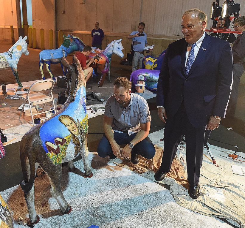 . PETE BANNAN-DIGITAL FIRST MEDIA    The Philadelphia 2016 Host Committee for the Democratic National Convention unveiled 57 fiberglass �Donkeys Around Town.�  Each of the donkeys represents a Democratic delegation that will be in town for the Convention and, upon completion, will be placed around Philadelphia to celebrate the 2016 Democratic National Convention.  Kevin Washo, crouched and Gov. Ed Rendell admire the Knsas donkey.