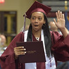 PETE  BANNAN-DIGITAL FIRST MEDIA           Lower Merion senior Alana Shavers waves to family members during graduation Wednesday evening at Hagan Arena St. Joseph's University.