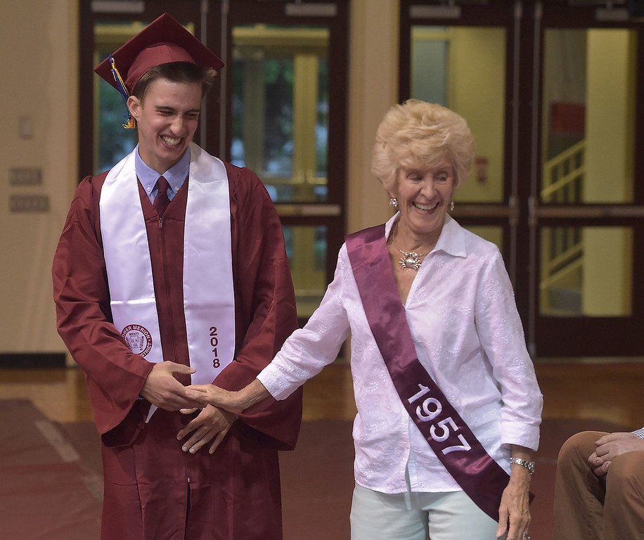 . PETE  BANNAN-DIGITAL FIRST MEDIA           Lower Merion senior Henry Finch greets Patsy DiPuppo, Lower Merion Class of \'57 at the start of commencement at Hagan Arena at St. Joseph\'s University Wednesday evening.