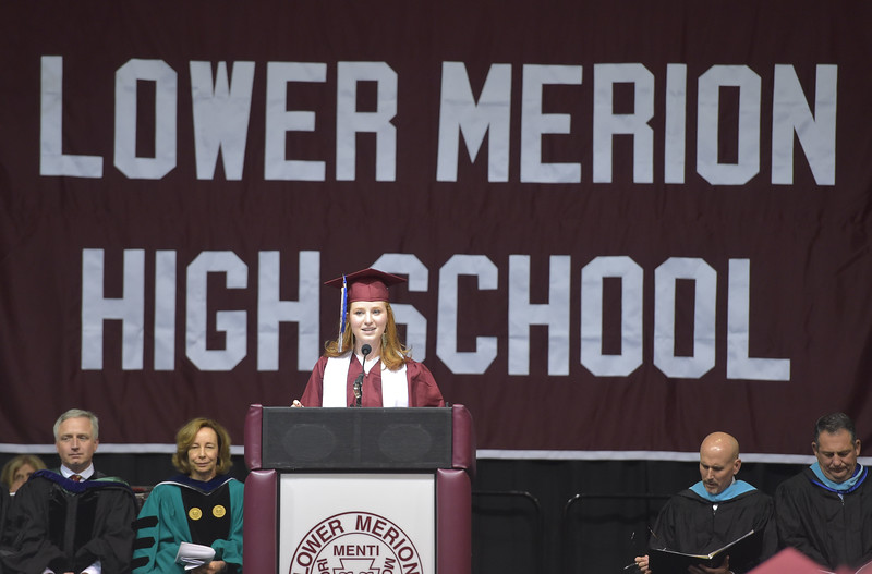 PETE  BANNAN-DIGITAL FIRST MEDIA           Lower Merion senior orator Molly Kaiser speaks during graduation Wednesday evening at Hagan Arena St. Joseph's University.