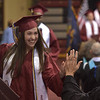 PETE  BANNAN-DIGITAL FIRST MEDIA           Lower Merion senior Marli Weisman gets a high-five from teachers after sch picked up her diploma at Hagan Arena at St. Joseph's University Wednesday evening.