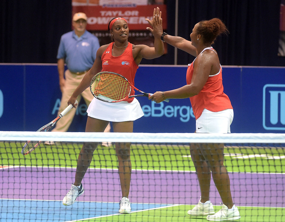. PETE BANNAN  DIGITAL FIRST MEDIA  Philadelphia Freedoms Sloane Stephens  and Taylor Townsend high-five after winning their doubles match at St. Joseph\'s University Hagan Arena against the New York Empire. Monday evening.