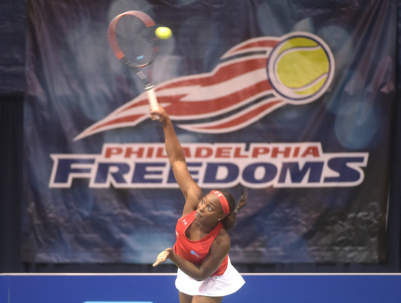 PETE BANNAN  DIGITAL FIRST MEDIA  Philadelphia Freedoms Sloane Stephens serves at St. Joseph's University Hagan Arena against the New York Empire. Monday evening.