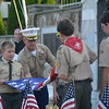 (Richard Ilgenfritz Main Line Media News) Col John Church USMCR and president of Valley Forge Military Academy showing a group of Boy Scouts how to fold the American flag during a ceremony in Wayne. Col John Church USMCR and president of Valley Forge Military Academy shows a group of Boy Scouts how to fold the American flag during a ceremony in Wayne.