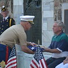 (Richard Ilgenfritz Main Line Media News) Col. John Church hands an American flag to Stephen Domenick following a ceremony recognizing his father and five uncles who served in Would War Two. Col. John Church hands an American flag to Stephen Domenick following a ceremony recognizing his father and five uncles who served in Would War II.