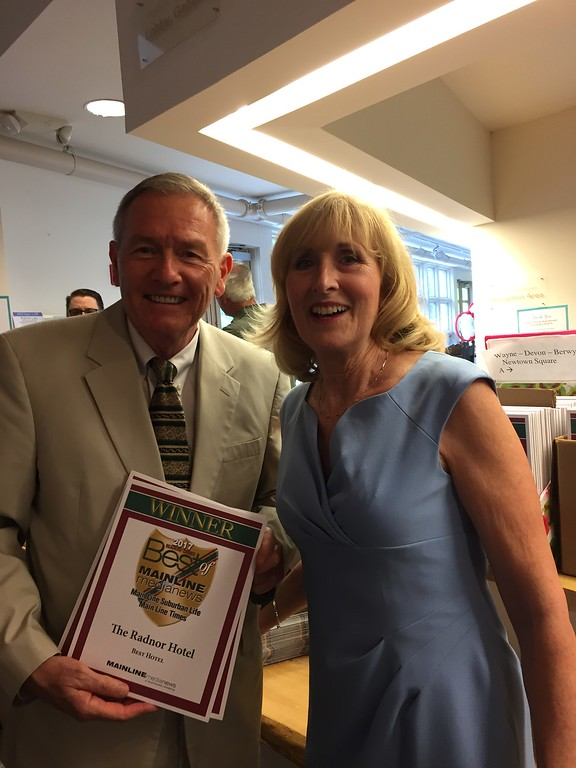 . Lou Prevost, Senior Vice President of The Radnor Hotel, receives awards from Main Line Media News\' Kathy O\'Keeffe, for Best Hotel, Best Buffet, and Best Fine Dining for Paramour at the Wayne Hotel.