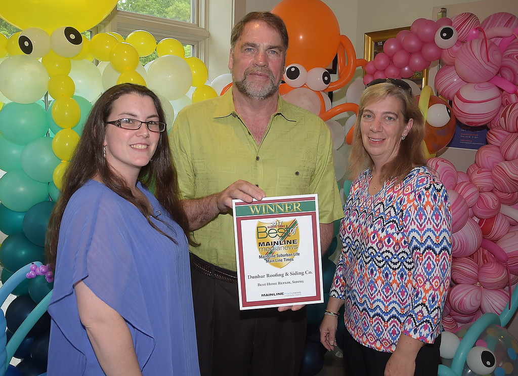 . PETE BANNAN - DIGITAL FIRST MEDIA      The Main Line Readers Choice Party was held at the Wayne Art Center Wednesday.  (Left to right) Crystal Brasof, Dennis Dunbar and Holly Fregeau of Dunbar Roofing & Siding Co. in Berwyn were among the businesses honored as the Best of the Main Line.