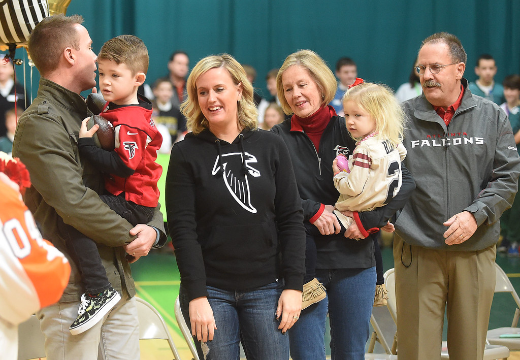 . PETE  BANNAN-DIGITAL FIRST MEDIA    The family of Atlanta Falcon quarterback Matt Ryan attended a rally at SS. Philip & James school in Exton Monday.   (Left to right) Mike Jr., whom the family calls Motts holds his son Ben,5,sister Kate Magee, parents Bernie and Mike Sr. with graddaughter Pierce Ryan,3. Matt Ryan graduated from the school in 1999. The rally was part of the school\'s kick-off of Catholic School\'s Week.   Students brought in cans goods for area poor as part of the program.