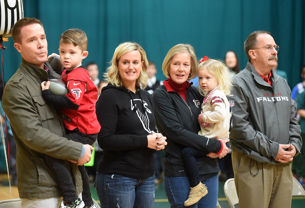 . PETE  BANNAN-DIGITAL FIRST MEDIA    The family of Atlanta Falcon quarterback Matt Ryan attended a rally at SS. Philip & James school in Exton Monday.   (Left to right) Mike Jr., whom the family calls Motts holds his son Ben,5,sister Kate  Ryan Magee, parents Bernie and Mike Sr. with graddaughter Pierce Ryan,3. Matt Ryan graduated from the school in 1999. The rally was part of the school\'s kick-off of Catholic School\'s Week.   Students brought in cans goods for area poor as part of the program.