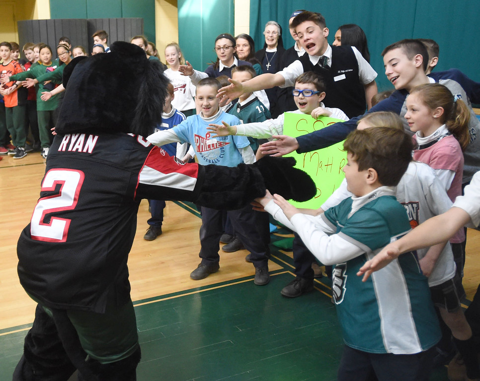 . PETE  BANNAN-DIGITAL FIRST MEDIA    The SS. Philip & James mascot gets students excited at the Super Bowl of Caring rally  at the school in Exton Monday.  The rally was part of the school\'s kick-off of Catholic School\'s Week.  Matt Ryan graduated from the school in 1999. Students brought in cans goods for area poor as part of the program.