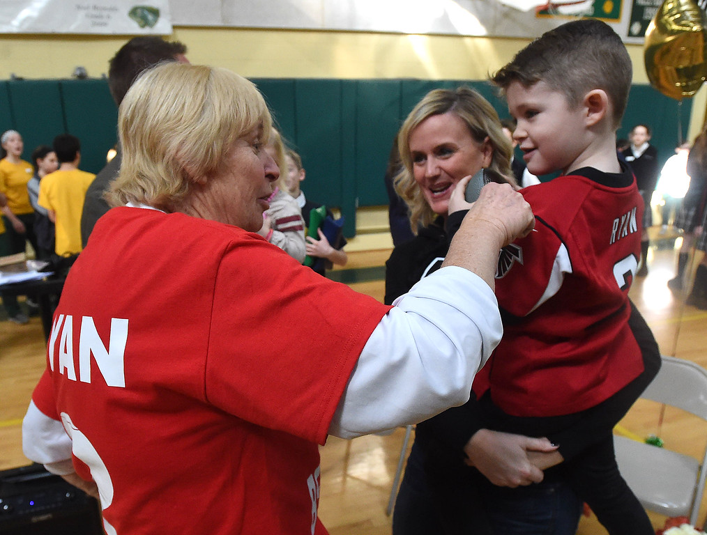 . PETE  BANNAN-DIGITAL FIRST MEDIA   The SS. Philip & James school gym teacher, Wendy Schenk talks with Ben Ryan,5 and  his aunt, Kate Ryan Magee. Schenk taught Atlanta Falcon\'s quarterback Matt Ryan at SS. Philip & James. He graduaterd in 1999.