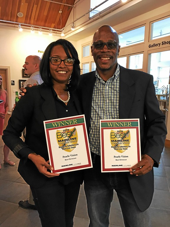 ". Quishonda Johnson, store manager. and Paul Smith, lab manager, at Pearl Vision Center, win for ""Best Optician.\"""