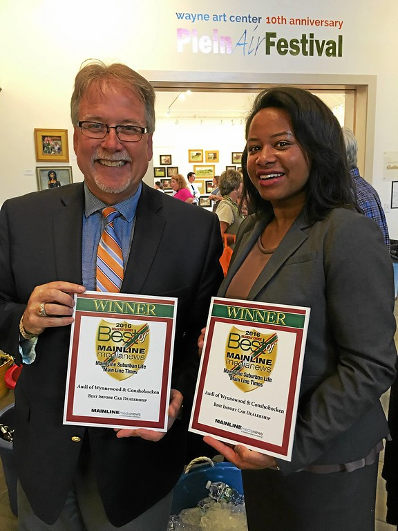 . Best Import Car Dealership Winner, Audi of Wynnewood\'s Marketing Director Faye Strothers with Main Line Media New\'s Multimedia Sales Representative Mark Bruce.