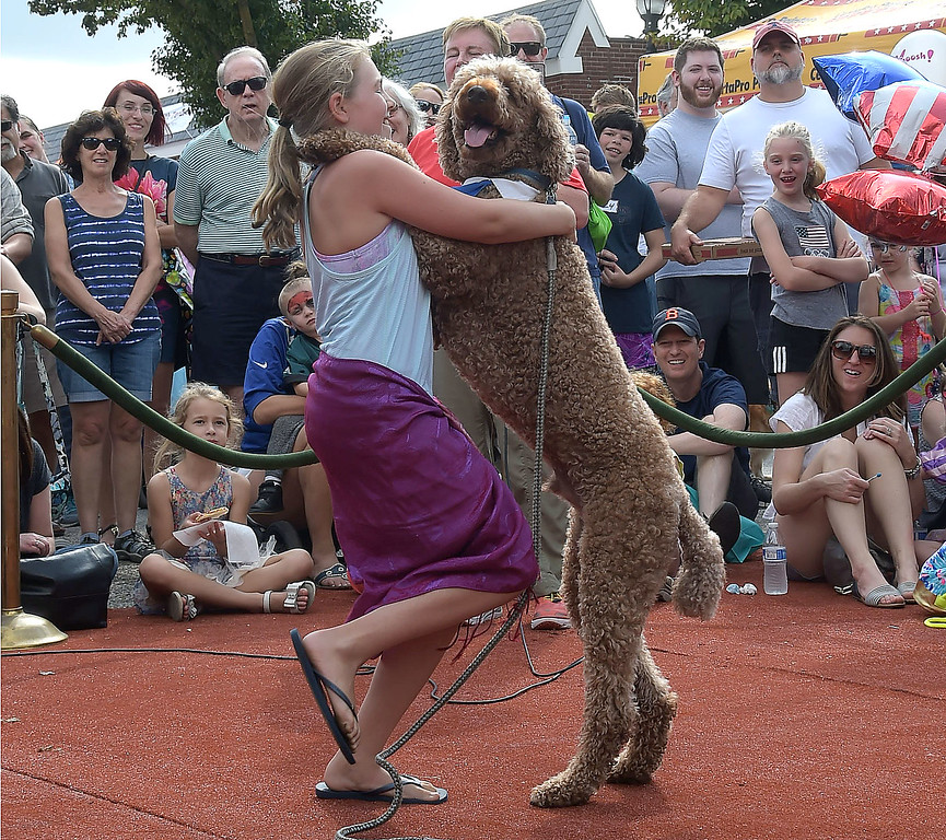 . PETE  BANNAN-DIGITAL FIRST MEDIA      Betsy Bauer dances with Rocky during the Top Dog contest Sunday.
