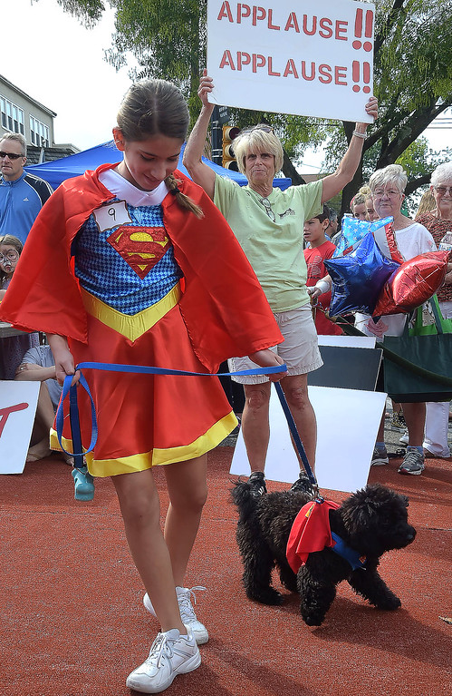 . PETE  BANNAN-DIGITAL FIRST MEDIA     Grace Gordon,11, of Wayne shows off Teddy, The Top Dog winner at the Wayne Fall Festival Sunday.