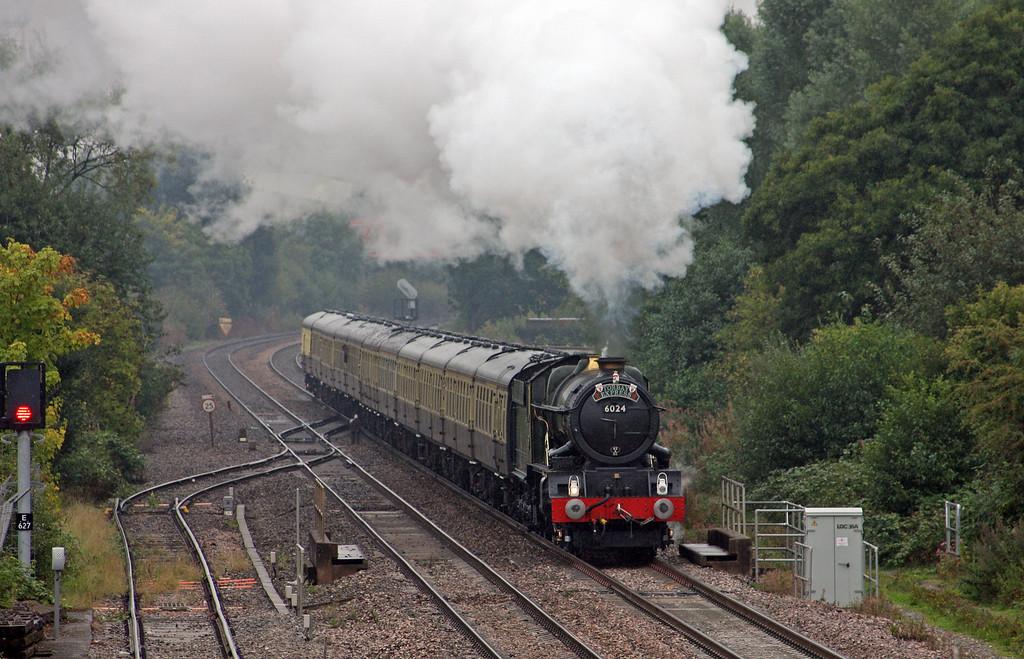 6024, 09.15 Bristol Temple Meads-Kingswear, Torbay Express, Norton Fitzwarren, near Taunton, 5-09-10, in heavy rain.