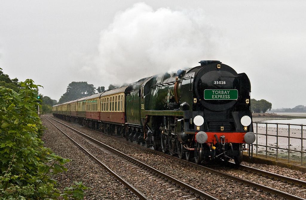 35028, 08.00 Bristol Temple Meads-Kingswear, via Westbury, Torbay Express, Powderham, near Exeter, 20-8-17. Delayed Exeter, passenger unwell.
