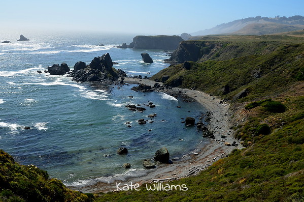 Near Munez Ranches. Beach accessible via steep path and rope line.