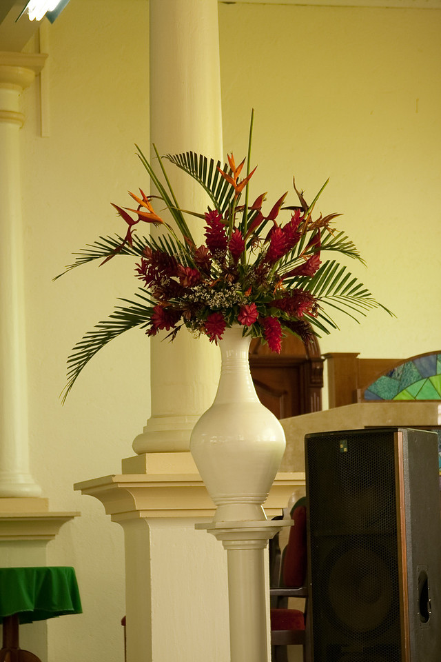 Flower arrangement (rich Heliconias and ginger flowers) adorning a church in La Fortuna, Costa Rica.