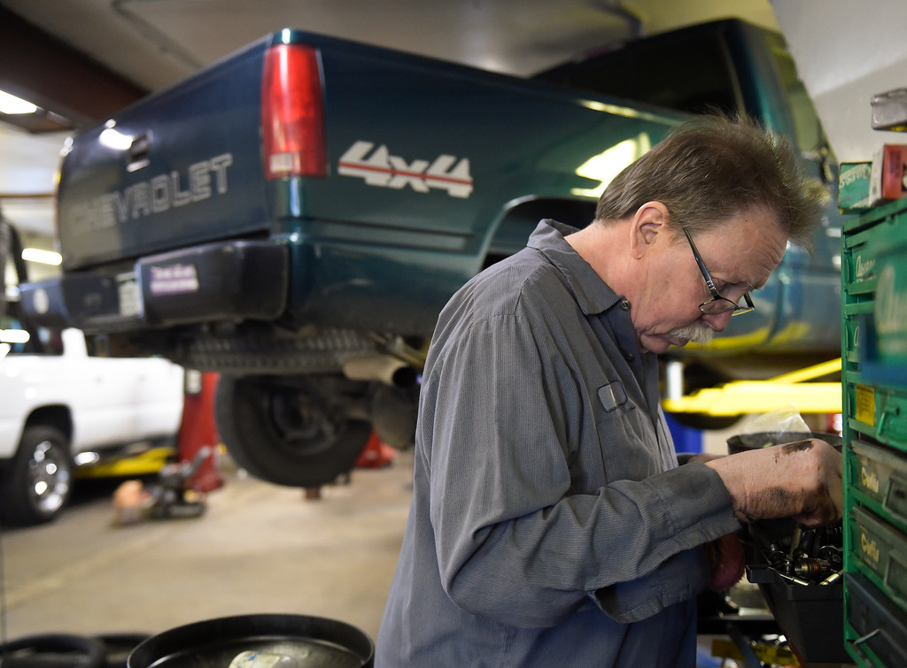 . LONGMONT, CO - NOVEMBER 29: Mark Strauss looks for a bolt while working on a Chevrolet pickup at Carworks of Longmont Auto Repair Nov. 29, 2018. Carworks is located at 1406 Coffman St. (Photo by Lewis Geyer/Staff Photographer)
