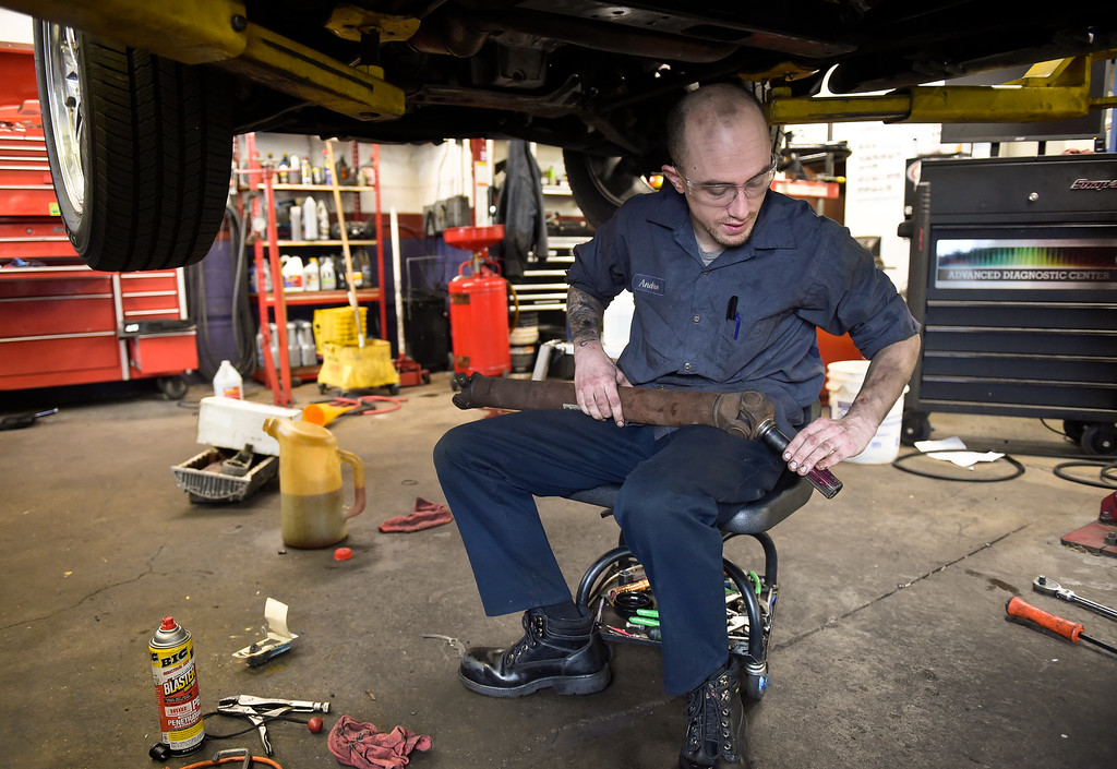 . LONGMONT, CO - NOVEMBER 29: Andre Lambart prepares to install the front driveshaft in a Chevrolet Suburban at Carworks of Longmont Auto Repair Nov. 29, 2018. Carworks is located at 1406 Coffman St. (Photo by Lewis Geyer/Staff Photographer)