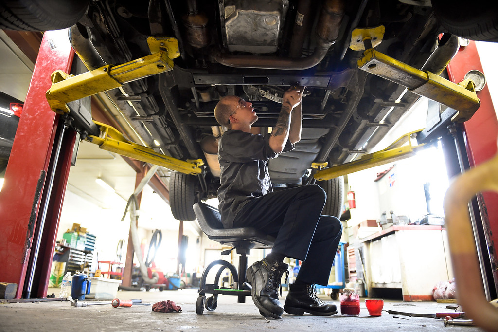 . LONGMONT, CO - NOVEMBER 29: Andre Lambart installs the front driveshaft in a Chevrolet Suburban at Carworks of Longmont Auto Repair Nov. 29, 2018. Carworks is located at 1406 Coffman St. (Photo by Lewis Geyer/Staff Photographer)