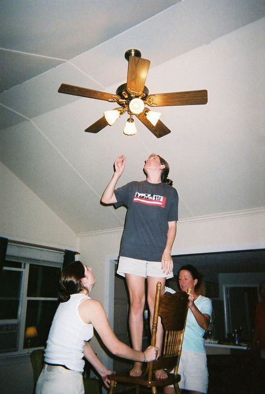 Trying to get the ceiling fan to work - Kelly and Teri had to hold a chair steady for me to be able to reach all the way up there...