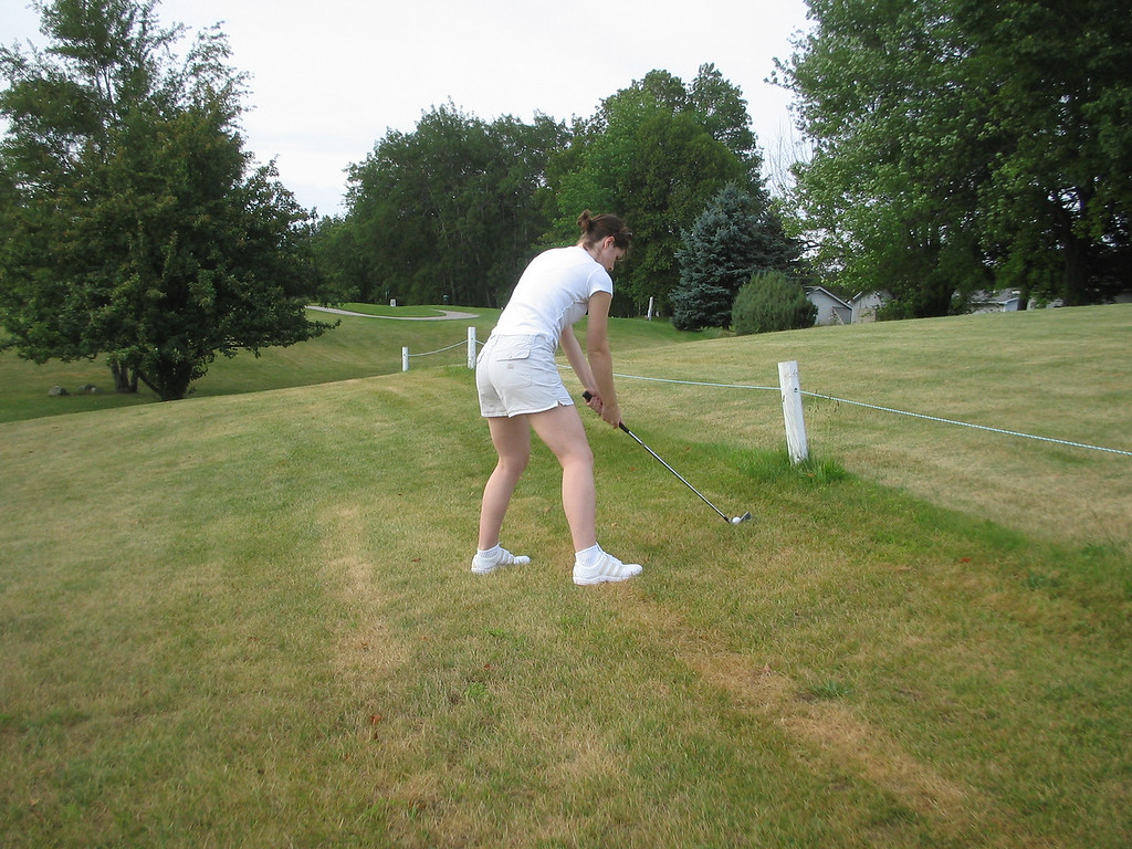 Kelly golfing