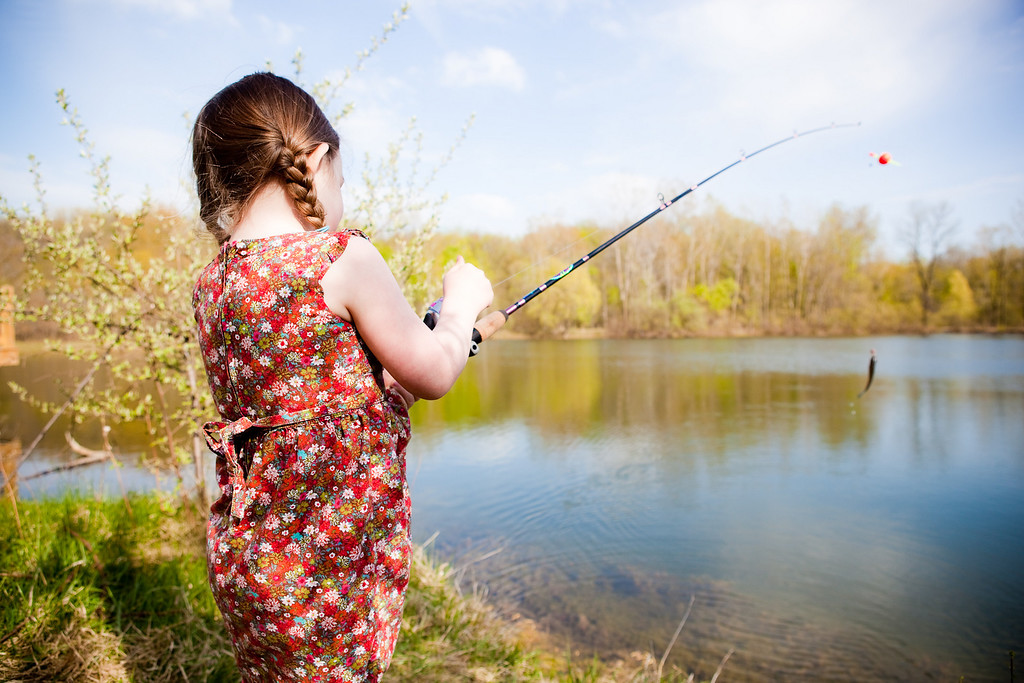 reeling in her first fish all by herself! April 21, 2010