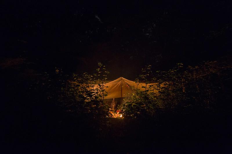 campfire under tarp