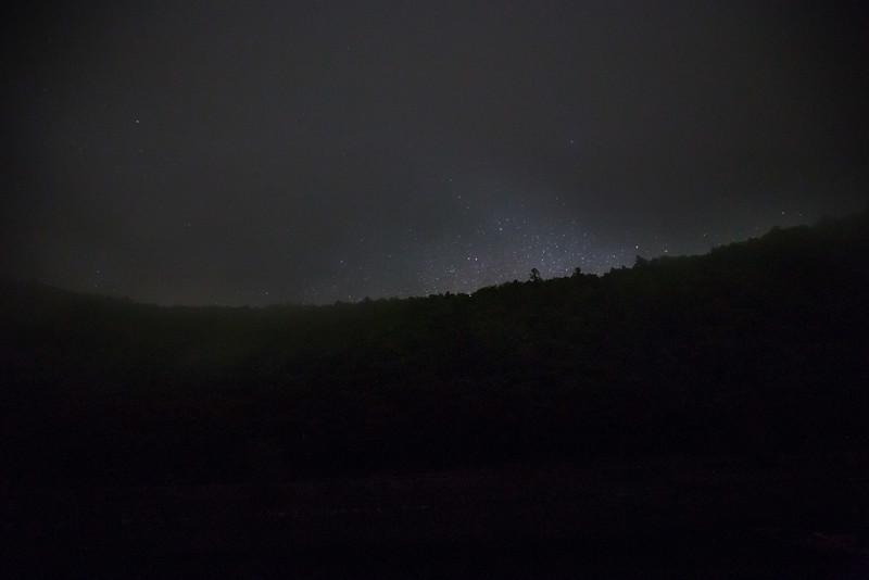 stars poking through fog