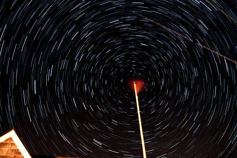 north star over  flag pole.  Composite timelaps