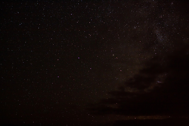 The Milky Way being covered by clouds.