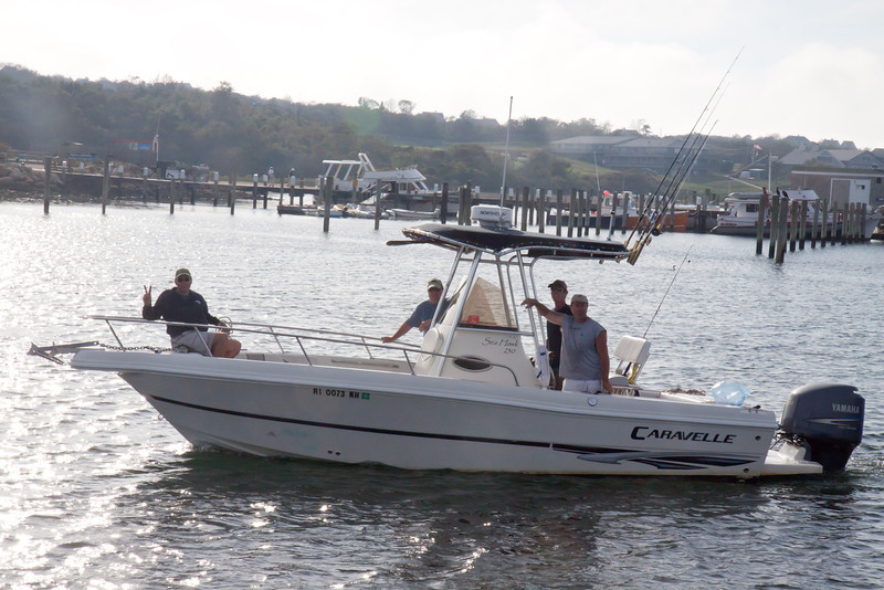 A group returns on Ken's boat after an afternoon of bottom fishing for sea bass and scup.