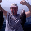 Photo by Ken Anderson.  Bob shows he is in his element on a boat!  Two keeper Sea Bass.