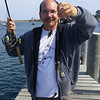 I have three small sea bass at one time.  Fishing from the dock is a fun way of passing the time.  95% very small fish.