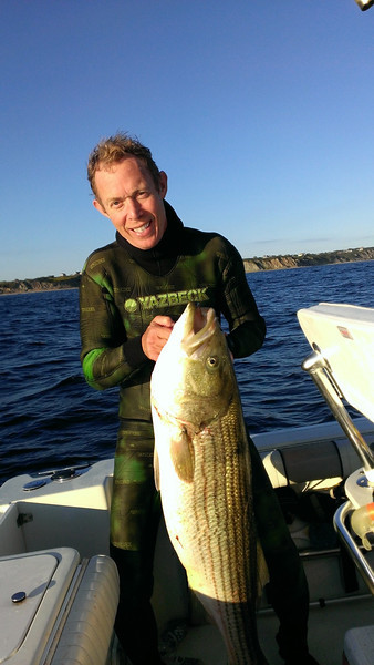 Ken with large stripped bass shot spear fishing. - photo from Ken