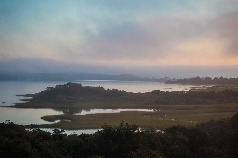 salt pond during sunset from porch of house.